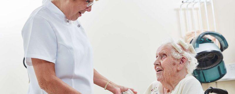 Elderly lady and hairdresser in salon