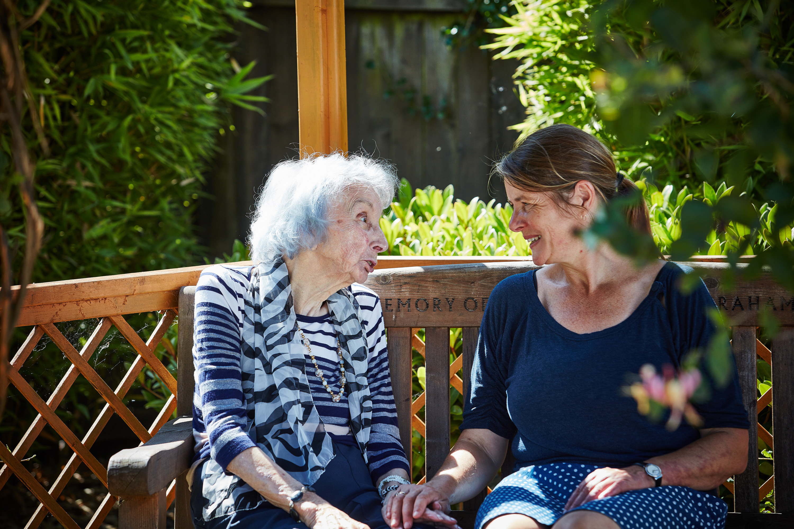 nurse and lady talking in garden at nursing home in cramond edinburgh