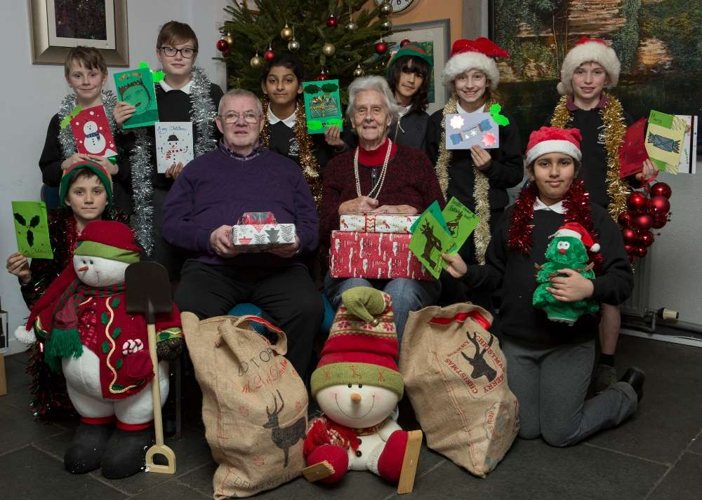 Pupils from Cramond Primary School deliver presents to the elderly for Christmas appeal