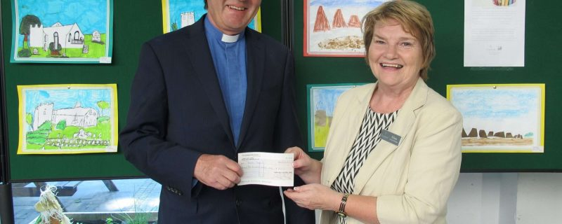 Eileen Gray from Cramond Residence handing donation to Russell Barr