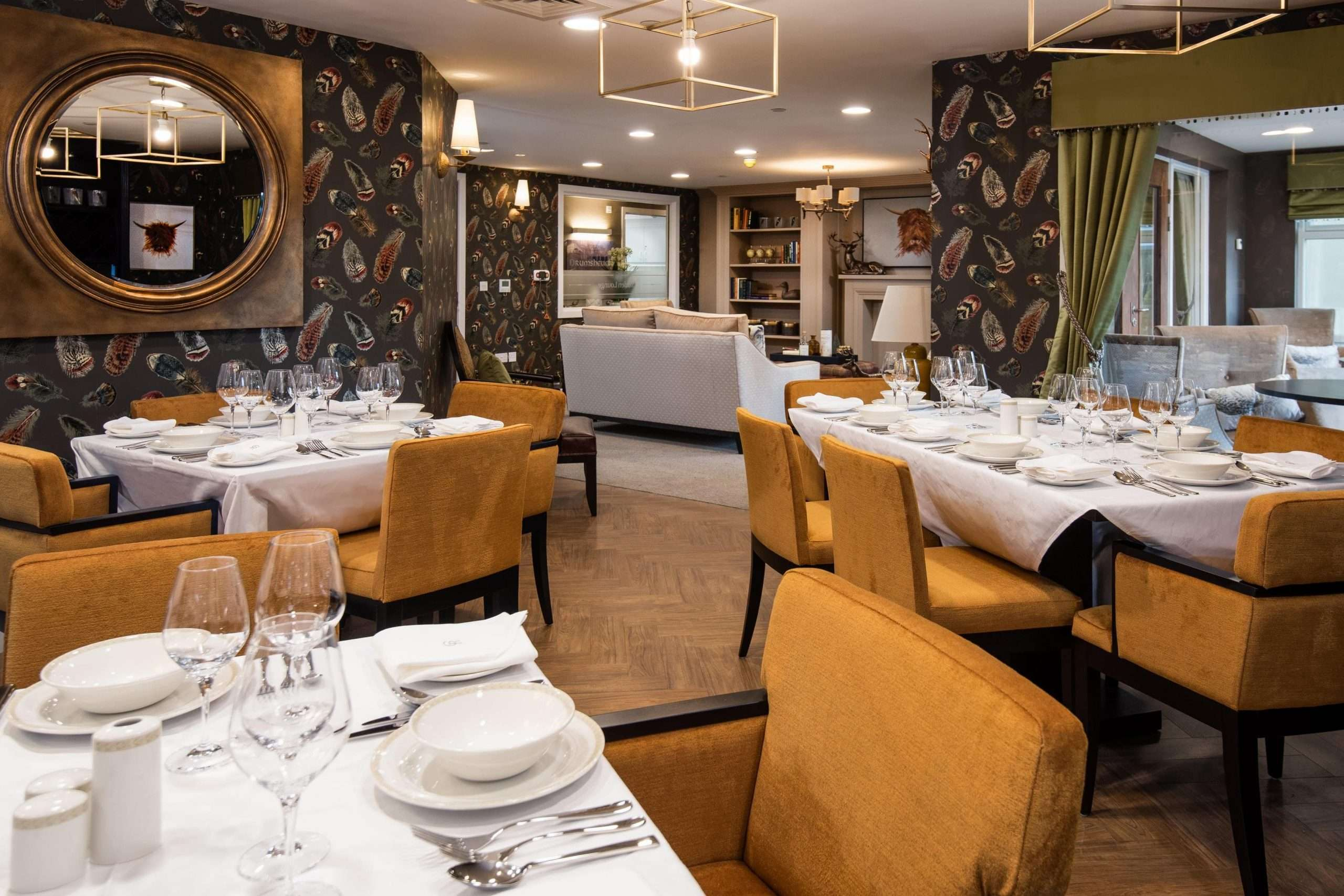 Fine dining room with tables, chairs and crockery