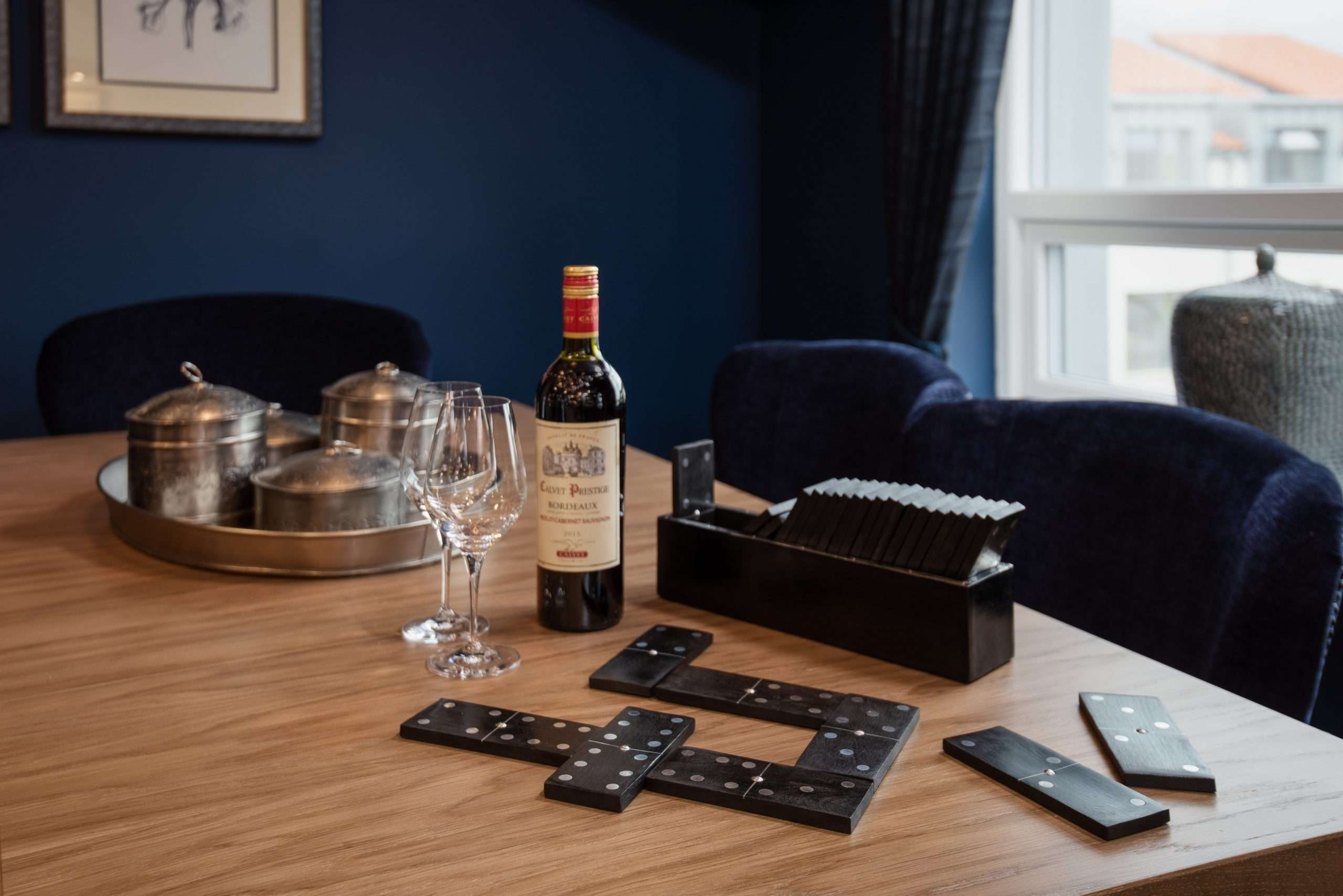 Dominos and wine in games room