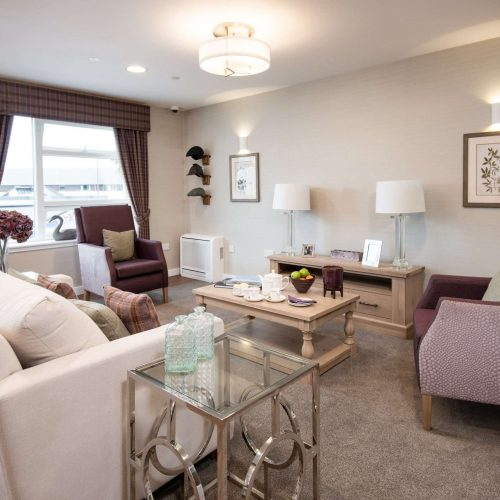 Lounge area with multiple chairs at care home