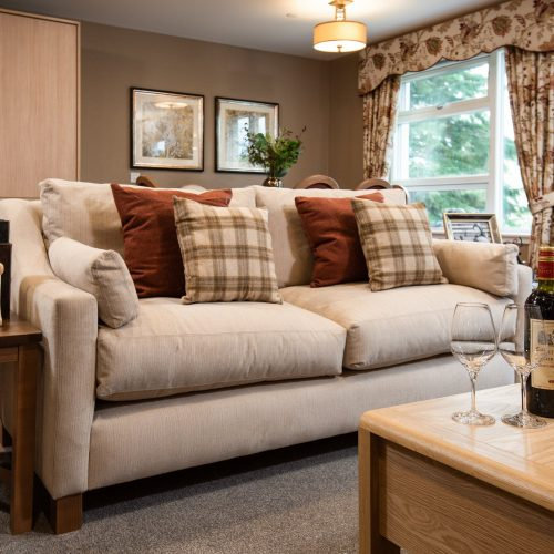 Sofa and wine with glasses at care home