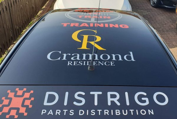 cramond residence logo on top on black racing car for flying haggis racing team