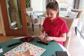 Staff member playing board games