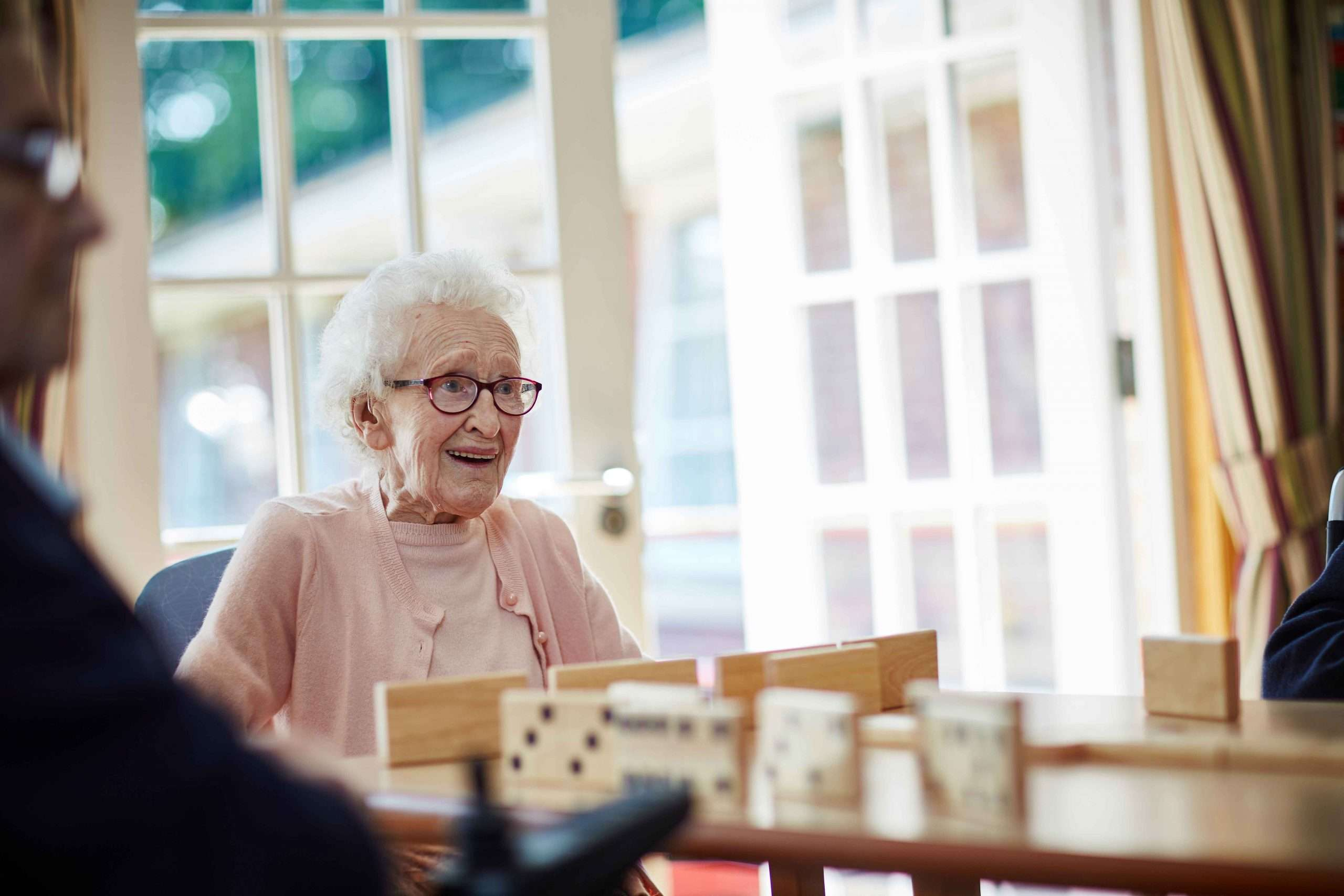 Resident smiling playing game