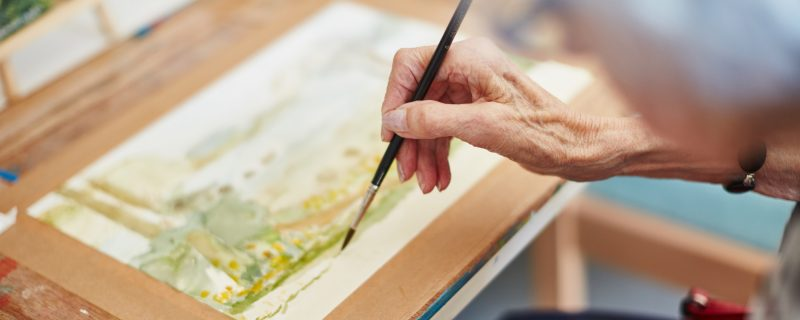 Elderly woman painting