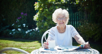 One of the residents enjoying tea in the garden