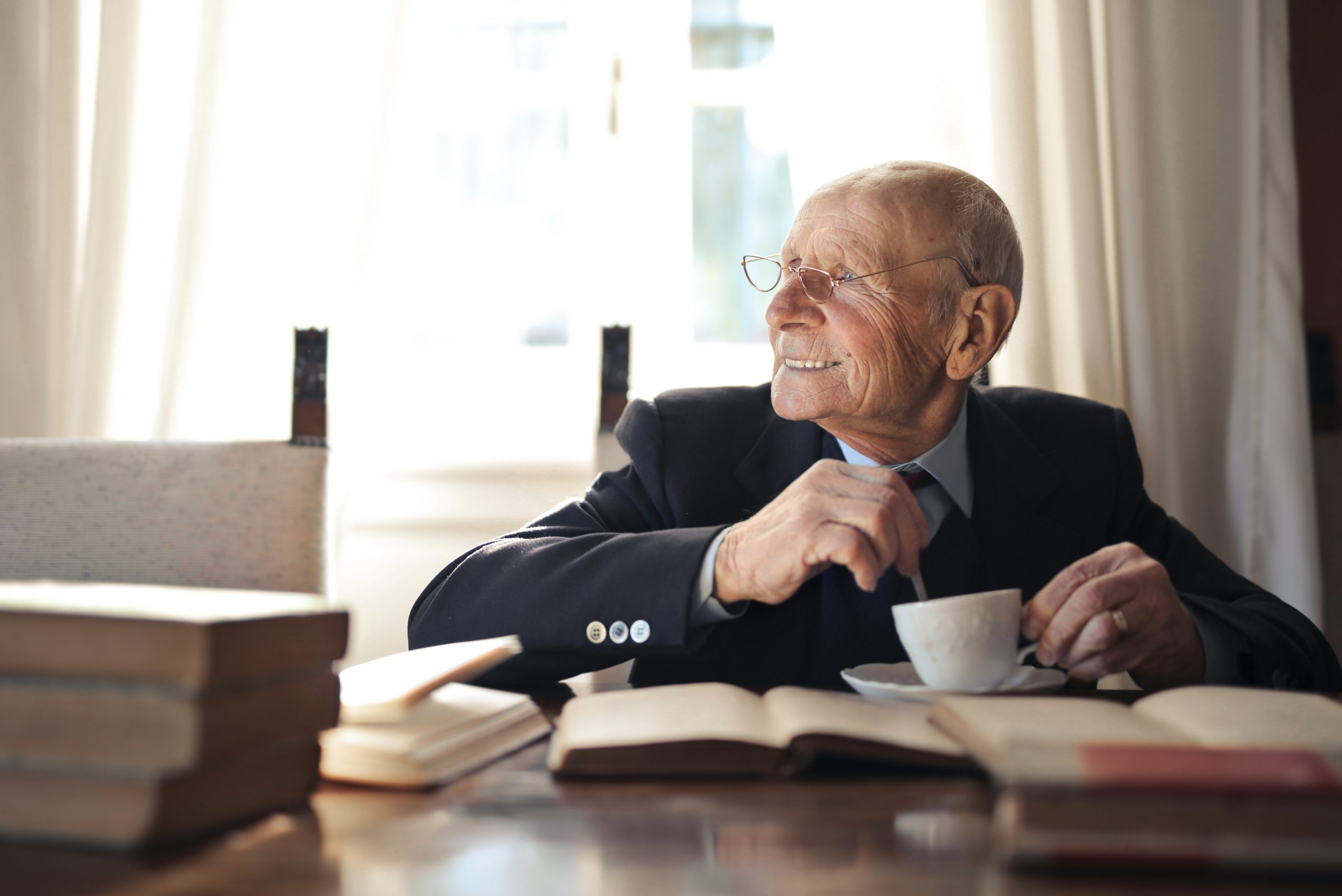 Man smiling with coffee