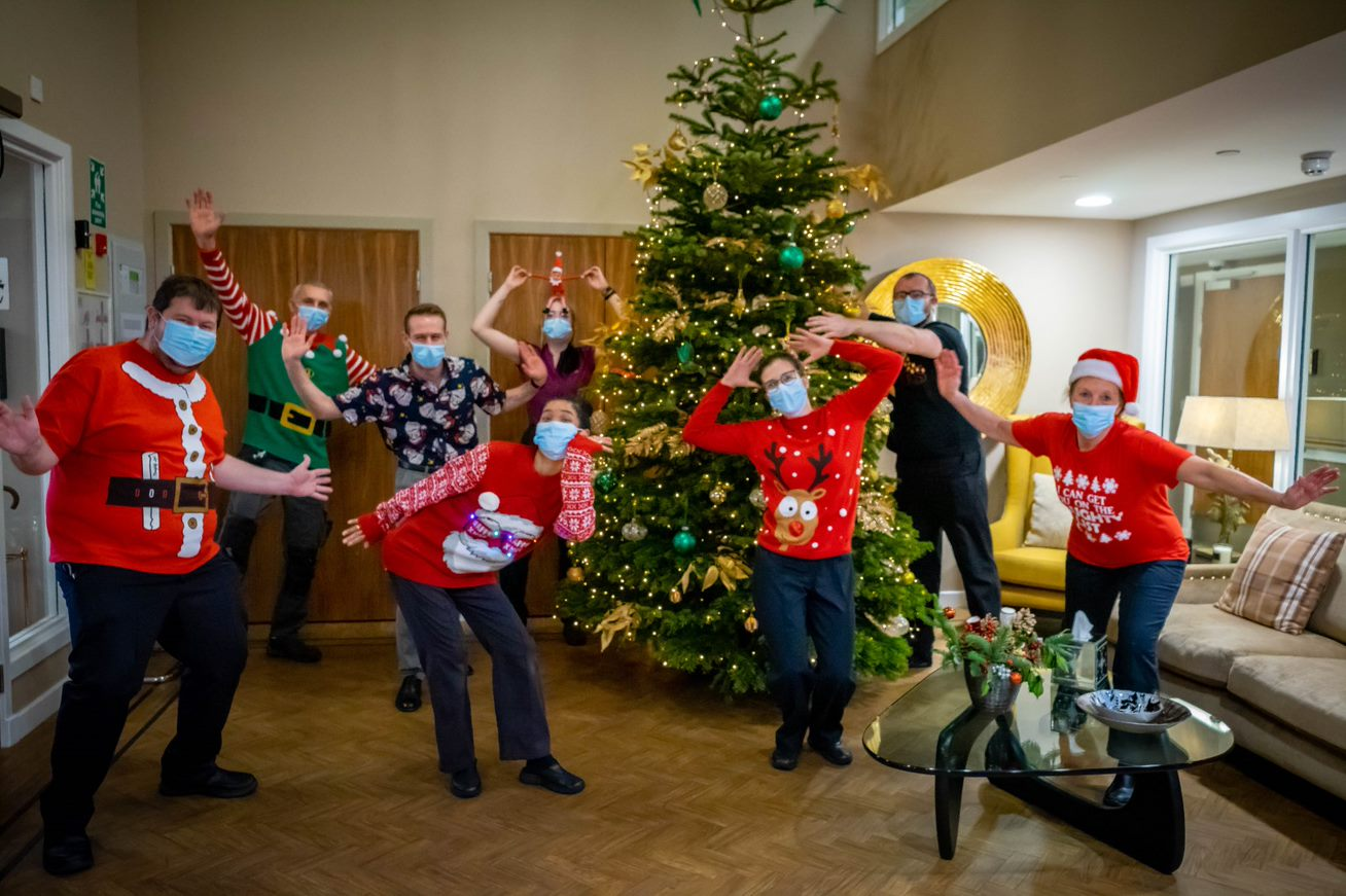 staff in Christmas jumpers
