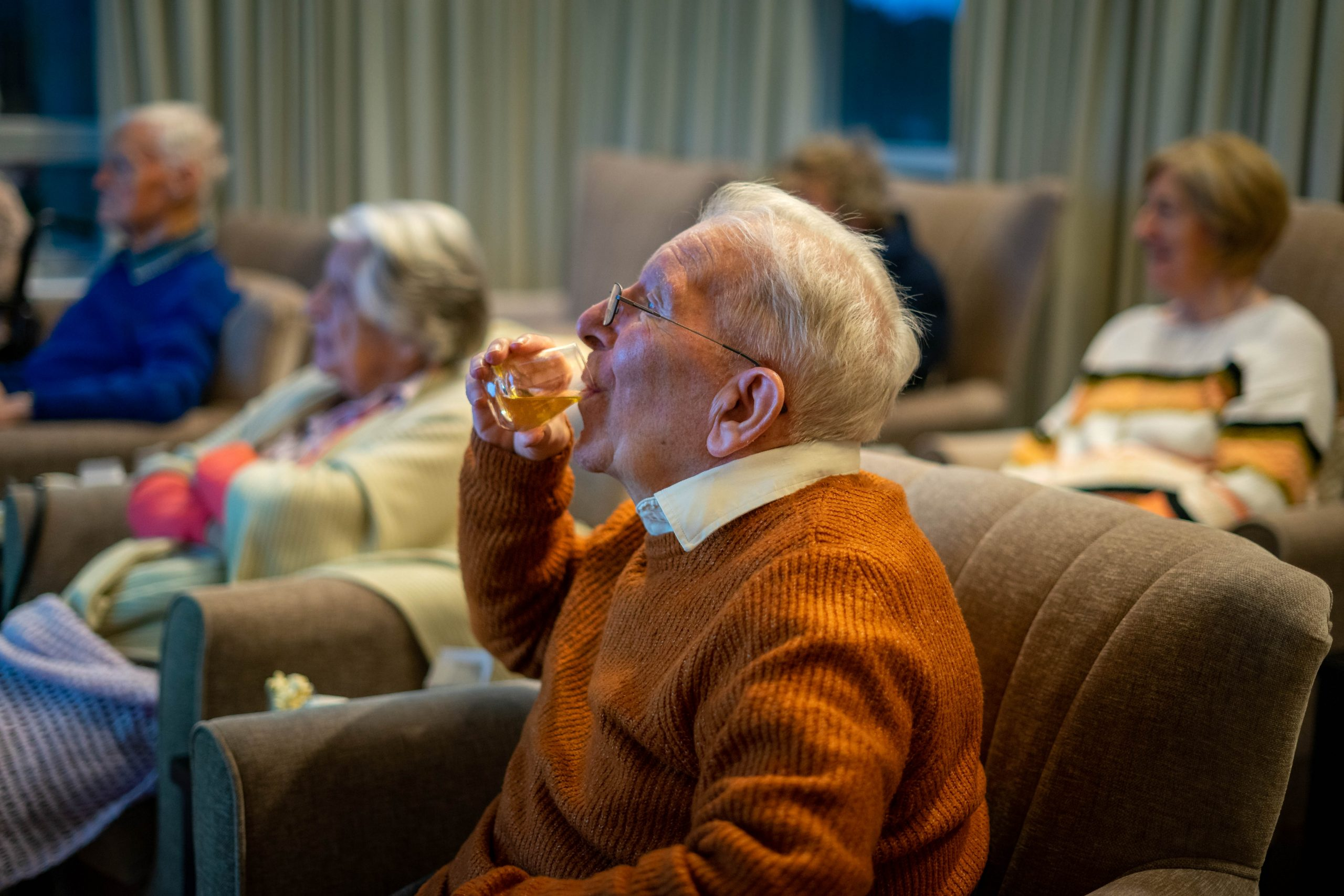 Resident drinking whisky from virtual tour